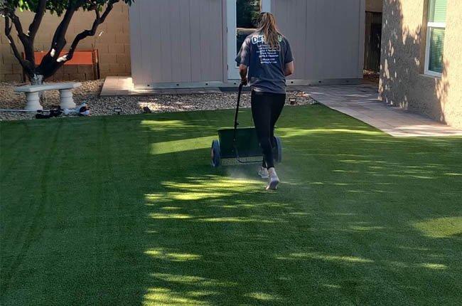 Dirty Turf Team Member Cleaning Backyard Turf